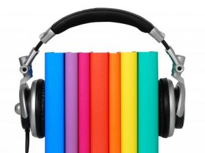 selection of books with headphones surrounding them
