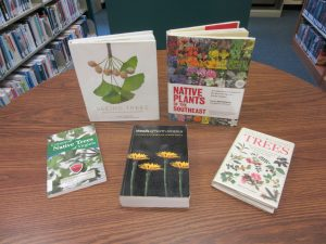 5 books about plant identification on table