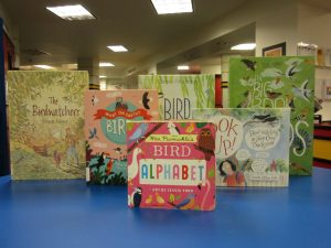 Various books about bird watching on table