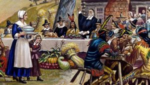 pilgrims and american Indians at thanksgiving meal