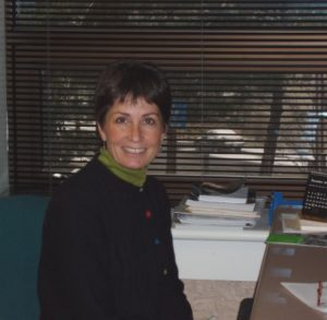Picture of Maria Del Rosso sitting at desk in front of window